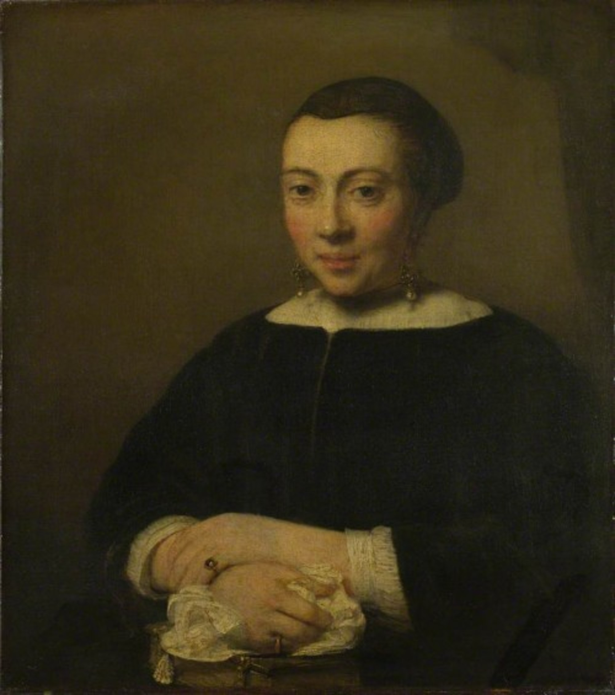 Willem-Drost---Portrait-of-a-Young-Woman-with-her-Hands-Folded-on-a-Book.jpg